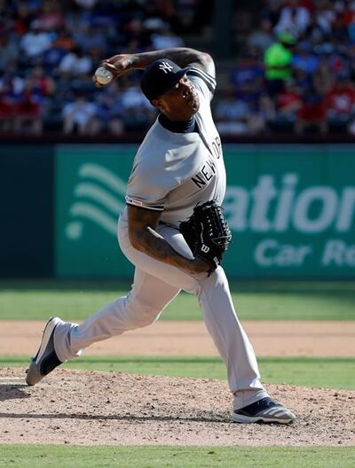 New York Yankees relief pitcher Aroldis Chapman throws to the Texas Rangers in the eighth inning of a baseball game in Arlington, Texas, Sunday, Sept. 29, 2019. (AP Photo/Tony Gutierrez)
