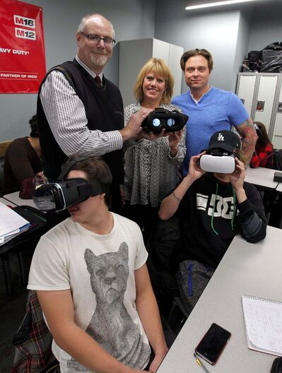 BORIS MINKEVICH / WINNIPEG FREE PRESS</p><p>Manitoba Construction Sector Council executive director Carol Paul, centre with Bruce Cielen (back left) of the Workers Compensation Board and Chris Taran (back right) of the International Brotherhood of Electrical Workers local 2085 training facility using a virtual reality training application.</p>