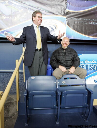 David Asper sings the praises of new seats for the proposed football stadium   sliding past Bomber President and CEO Lyle Bauer back in June 2008.