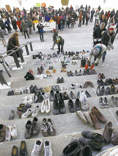 Activists were inspired to leave shoes on the steps of the legislature by Winnipeg Transit driver Kris Doubledee, who gave his footwear to a homeless man last year.