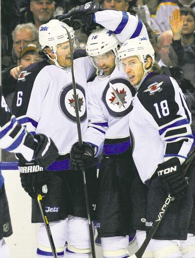 Gary wiepert / the associated pressWinnipeg Jets defenceman Ron Hainsey (6), left-winger Andrew Ladd (16) and centre Brian Little (18) celebrate Ladd�s winning goal in the second period Tuesday in Buffalo.