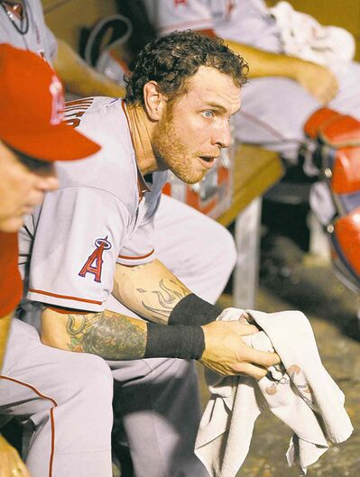 Josh Hamilton injured himself sliding head first into first base.