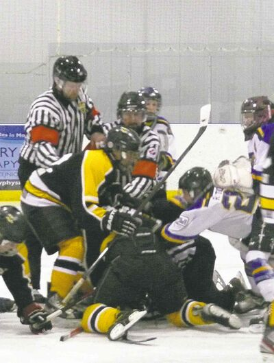 Chris Gareau photoA linesman is kicked and punched by players while prone on the ice in Stonewall.