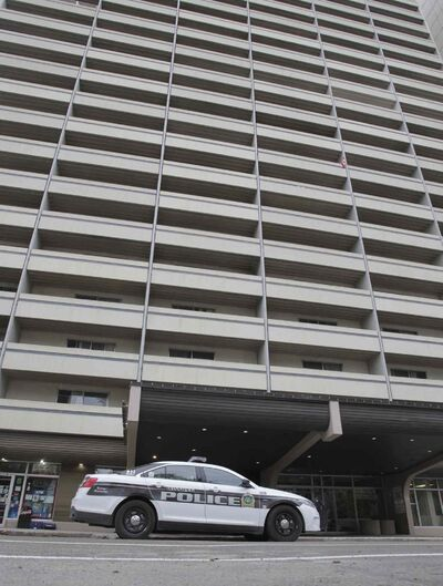 Police investigate at the Holiday Towers at 160 Hargrave St. Monday morning after a body was found.