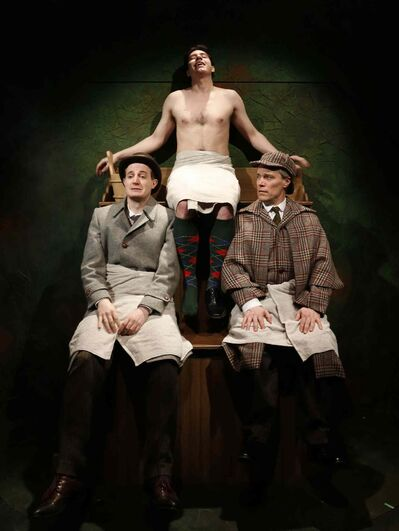 A scene from The Hound of the Baskervilles at the Prairie Theatre Exchange shows Sherlock Holmes (Gord Tanner),right with Dr. Watson (Toby Hughes) at left with Sir Henry (Aaron Pridham) above in a steam bath.