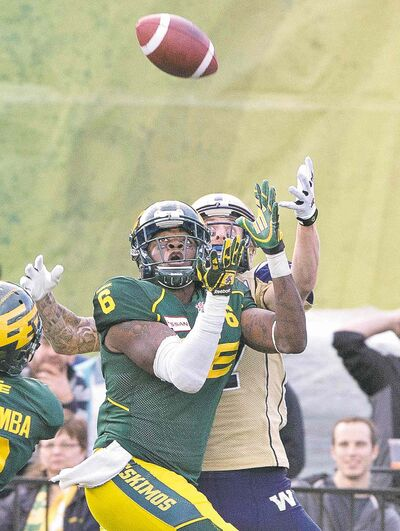 photos by jason franson / the canadian pressBombers receiver Rory Kohlert and the Eskimos� Alonzo Lawrence (6) battle for the throw during the second half Monday.