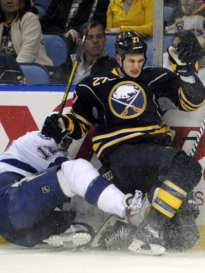 Tampa Bay Lightning Ryan Malone gets checked into the boards by Buffalo Sabres Adam Pardy during the second period of a game in Buffalo.