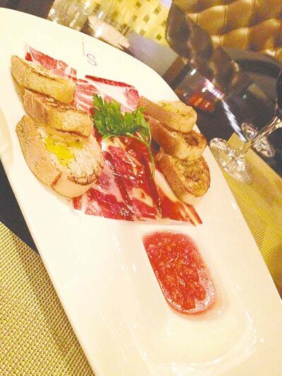 The Pata Negra ham is imported from Spain, sliced fresh and served with a garlic tomato sauce at Julian Serrano's tapas restaurant in Vegas's Aria.