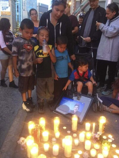 Family and friends of homicide victim Cyril Weenusk, including his spouse Lori Weenusk and their four children, participate in a vigil in July 2016 in downtown Winnipeg. (Boris Minkevich / Winnipeg Free Press files)</p>