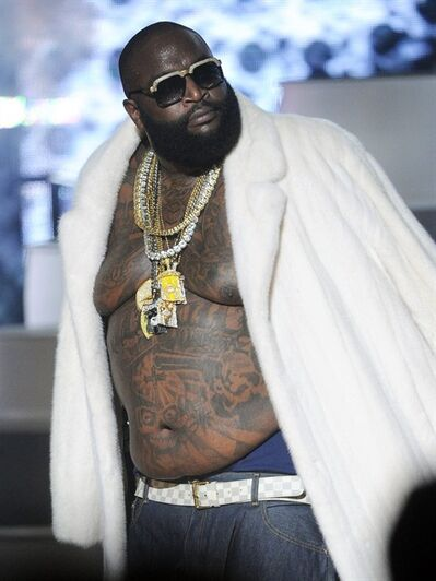 FILE - This Sept. 29, 2012 file photo shows Rick Ross performing at the BET Hip-Hop Honors at Boisfeuillet Jones Atlanta Civic Center in Atlanta. Police in South Florida say rapper Rick Ross crashed his Rolls Royce into a building after hearing shots fired nearby. Police say Ross and a female companion reported hearing multiple shots fired in their direction early on Monday, Jan. 28, 2013. Police say Ross lost control of the silver Rolls and crashed into an apartment building. Neither Ross nor his passenger was injured and police say it did not appear that any bullets struck the Rolls. (Photo by John Amis/Invision/AP, file)