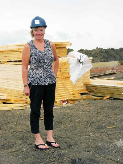 Randall Homes sales consultant Cheryl Thurston stands where the first four condo units were being constructed in Oak Bluff West in July 2013.
