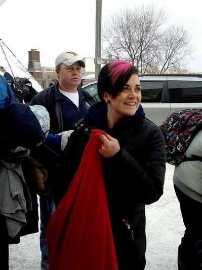 Ashley Meilleur, of Headingley, and other volunteers gave out donations of warm clothing, hygiene items and $10 gift cards to homeless people in Winnipeg's downtown on Christmas Day.