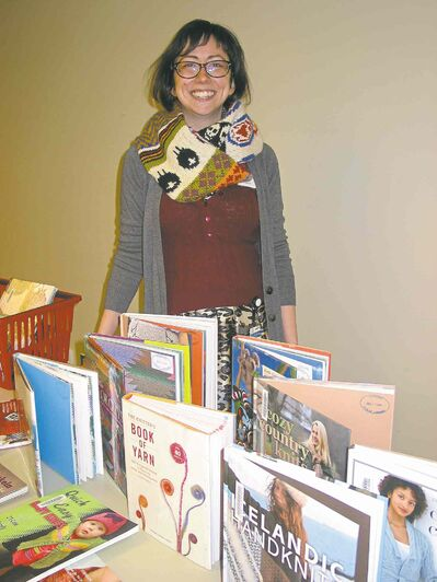 Laura Harby pictured with a selection of knitting books at Louis Riel Library, which is home to the Knit Night Book Club. The next meeting is scheduled for Jan. 8.