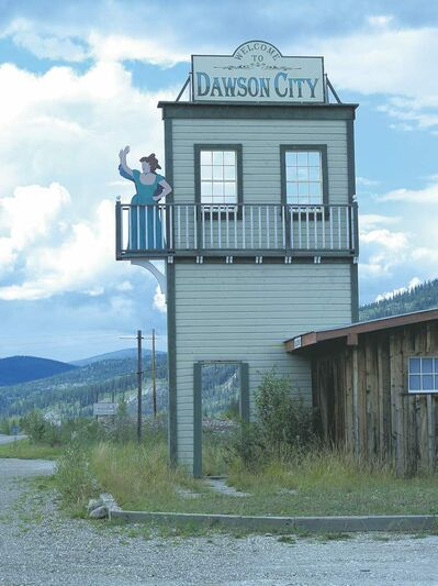 POSTMEDIA NEWSGuests are welcomed to Dawson City by a waving cancan girl, bringing to mind �good-time girl� Gertie Lovejoy.