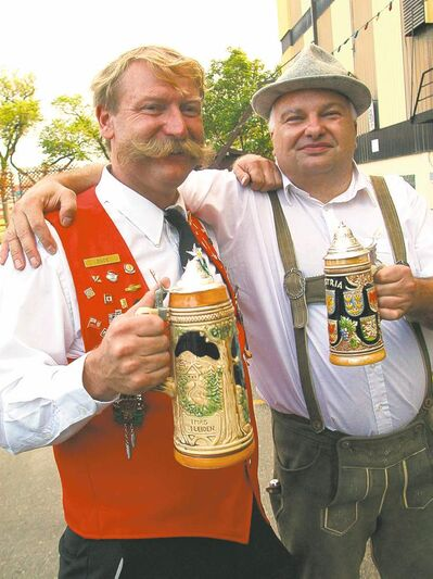 Karl Duesterdiek (left) and Frank Unger of the German Society Brass Band enjoy their beverages during Folklorama.