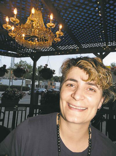 Kristina Nakoulas with her classy patio chandelier.