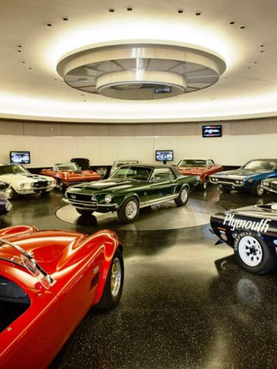 Craig Jackson built a circular garage to hold his cars on the hillside behind his house. The garage walls are leather, and the floor is coated with terrazzo