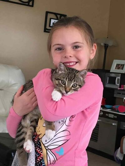 Isabelle Waite with cat Leo, who was killed June 24, believed by a coyote. (Supplied)