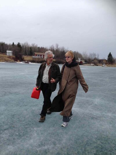 Council of Canadians chairwoman Maude Barlow (right) walks with Cuyler Cotton, media liaison for Shoal Lake 40 First Nation, across the ice between Shoal Lake 40 and Iskatewizaagegan Shoal Lake 39 Sunday.