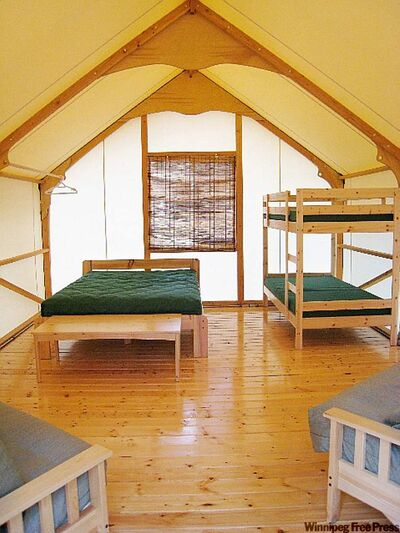Jasper's cottage tents have all the basics covered, including mattresses on raised beds, above. For $78.50 a night, including site fee and fire permit, visitors also receive a full site and safety orientation.