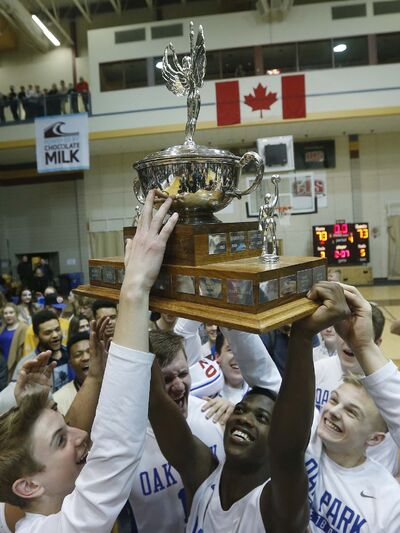 JOHN WOODS / WINNIPEG FREE PRESS</p><p>The Oak Park Raiders raise the Manitoba High School 2017 Varsity Boys Basketball Championship Monday after beating St. Paul&#39;s.</p>