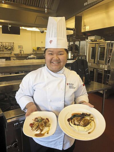 Student chef Leane Galang, 20, displays her appetizer and main course after winning the Iron Chef Turkey crown at Red River College&rsquo;s culinary school. (Supplied)</p></p>
