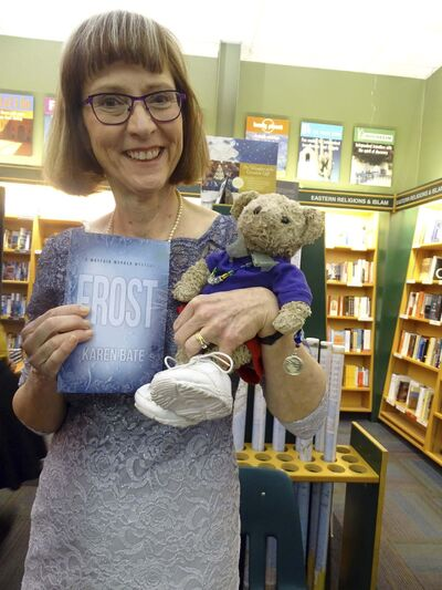 Author Karen Bate shows off her newest book, Frost. Quigley, her bear, joined her.</p>