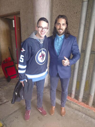 SUPPLIED</p><p>Philadelphia Zamboni driver Gideon Blum (left) with his hockey hero, Jets forward Mathieu Perreault.</p>