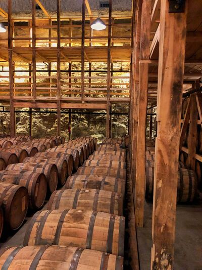 Maker&rsquo;s Mark Private Select, where restaurants and bars can sign up to create their own version of bourbon, ages in barrels in this unique warehouse built into the side of a hill. The rear wall is merely limestone exposed from blasting into the hill.</p>