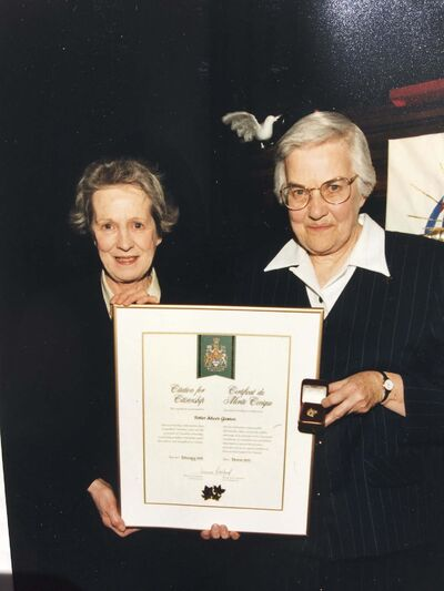 SUPPLIED</p><p>Sister Aileen Gleason (right) in 1999, receiving the Citation for Citizenship from the Chief Citizenship Judge of Canada, Elizabeth Willcock. </p>