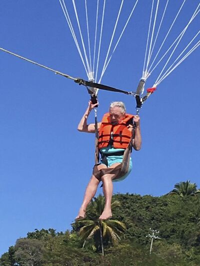 Bonnie Korzeniowski coming in for a landing on the beach in Puerto Vallarta in January 2018. At age 77, she was determined to parasail. (GERALD KORZENIOWSKI PHOTO)</p>