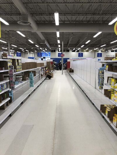Shoppers have emptied the shelves of paper products at the Superstore on St. Anne's Road Saturday. SUPPLIED</p>