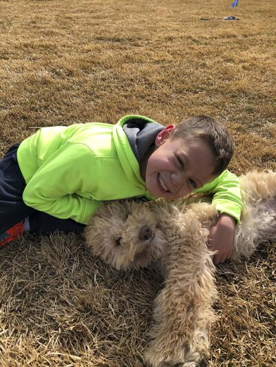 SUPPLIED</p><p>Guy Roussin, 11, with the family's Labradoodle, Rogue.</p>