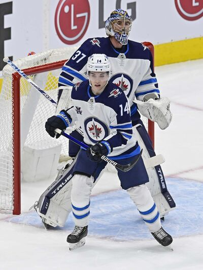 """Frank Gunn / The Canadian Press</p> <p>Jets defenceman Ville Heinola wasn't out of place in his second outing of the season, Thursday night against Toronto.</p> </p> <p>""""> </a><figcaption readability="""