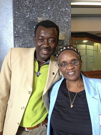Raymond Ngarboui, with Welcome Place's Marceline Ndayumvire, who welcomed him at the airport in 2005.