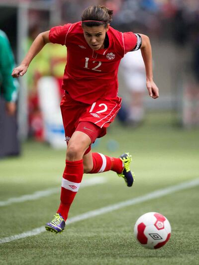 Canada's Christine Sinclair chases down the ball during an women's international friendly soccer game against Mexico in Vancouver, B.C.,  in 2013.  Canada will face the U.S. in a game in Winnipeg in May.