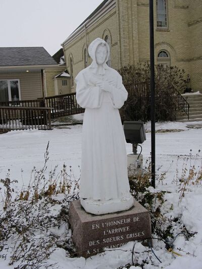 This statue, located in front of St. Francois Xavier Roman Catholic Church (1053 Hwy. 26) commemorates the Grey Nuns whose members lived in a convent near the church and served the  community from 1850 to 1968.