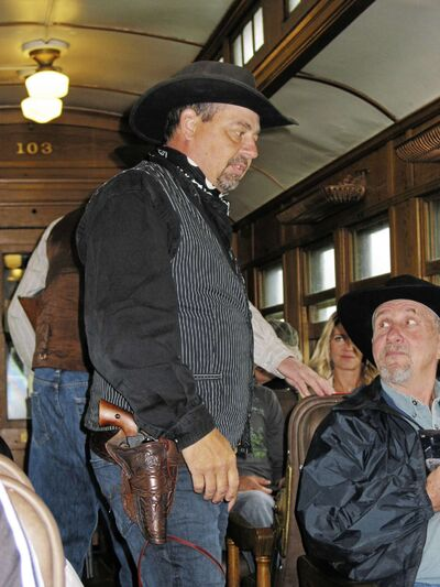 Volunteer Rick Peloquin takes on the roles of sheriff and train robber during the PDCR's Great Train Robbery.