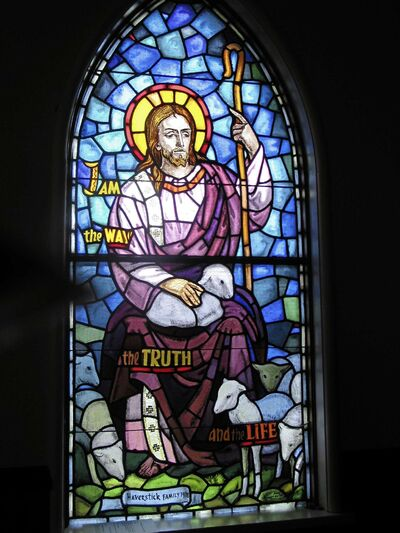 One of the stained glass windows inside Avonlea United Church that commemorate local families.