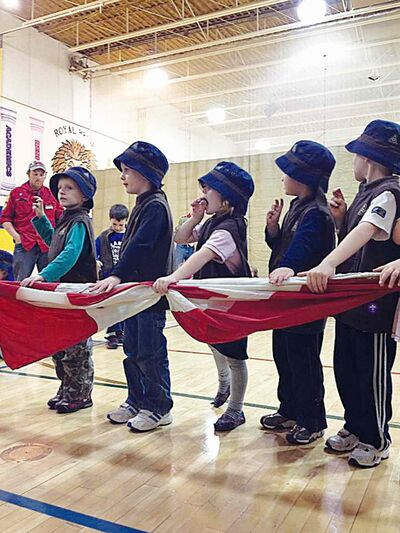 The 49th Winnipeg Beavers group in Charleswood participate in their Investiture Night ceremony.