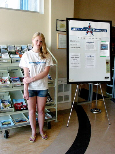 Mackenzie Major is ready to greet visitors to Jim's Vintage Garages/Headingley Heritage Centre at 5353 Portage Ave.