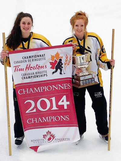 (Left) Kelly Arran, of La Salle, and Lauren Burton, of Oak Bluff, proudly hold the national championship banner and trophy that Team Manitoba won in the AA U19 national ringette championship, held from April 7 to 12 in Regina.