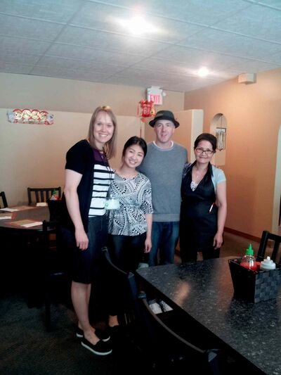 "Klassen and Burpee pose with the family who owns Pho Binh Minh (819 Sargent Ave.), Michele Huynh and ""Mama Ca"" Huynh."