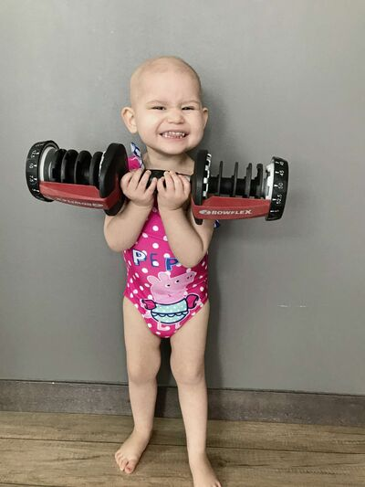 Maya Chernichan, 2, is pictured doing her best deadlift. Maya was recently diagnosed with acute lymphoblastic leukemia and will be going through cancer treatments for the next two years.
