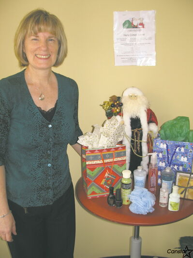 Lesley Hirose, office manager at Donna Sarna Physiotherapy & Rehabilitation is encouraging everyone to drop off donations for women and children.
