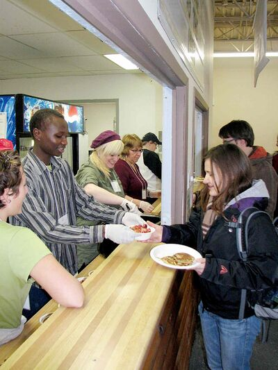 Volunteers serve pancakes at LITE's Wild Blueberry Pancake Breakfast last year. This year's is set for Nov. 22.