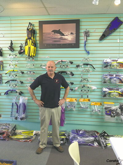 Ian Sutherland, owner of 3 Fathoms, shows off some of his wares at his Henderson Highway store.