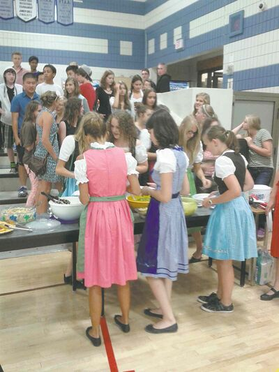 German exchange students enjoy a potluck meal at Acadia Junior High.