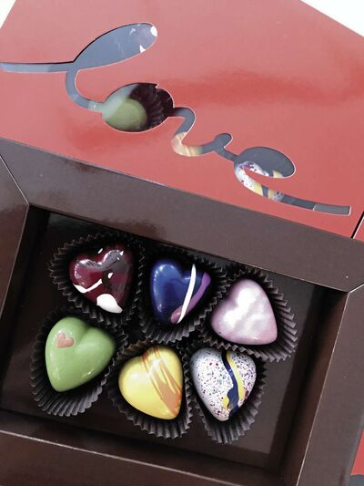 Valentine's Day chocolates from Chocolatier Constance Popp are handmade, multi-hued and heart-shaped.