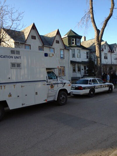 RCMP, Winnipeg police and forensic investigators have been working inside the home in the 100 block of Lorne Avenue since Tuesday evening.